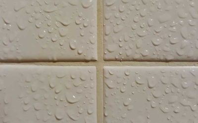 Is it OK to use bleach on my stained grout?