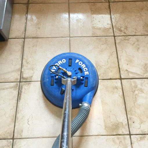 Cleaning a tile floor with grout